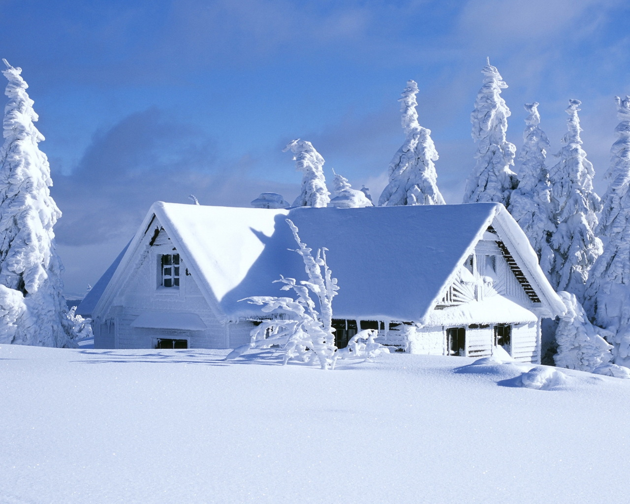 Mountain Chalet Covered with Snow