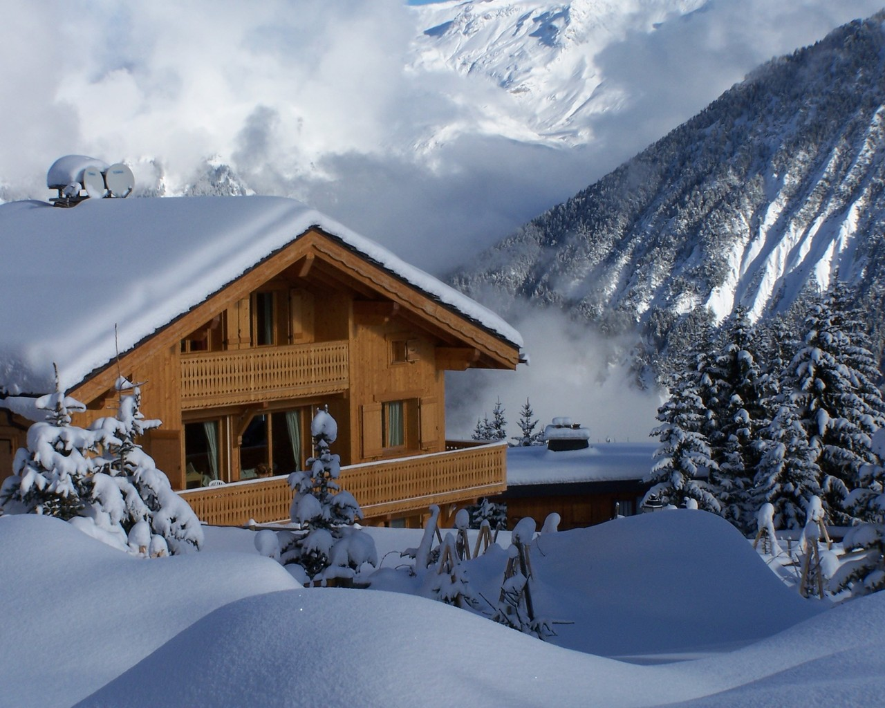 Wood chalet in winter
