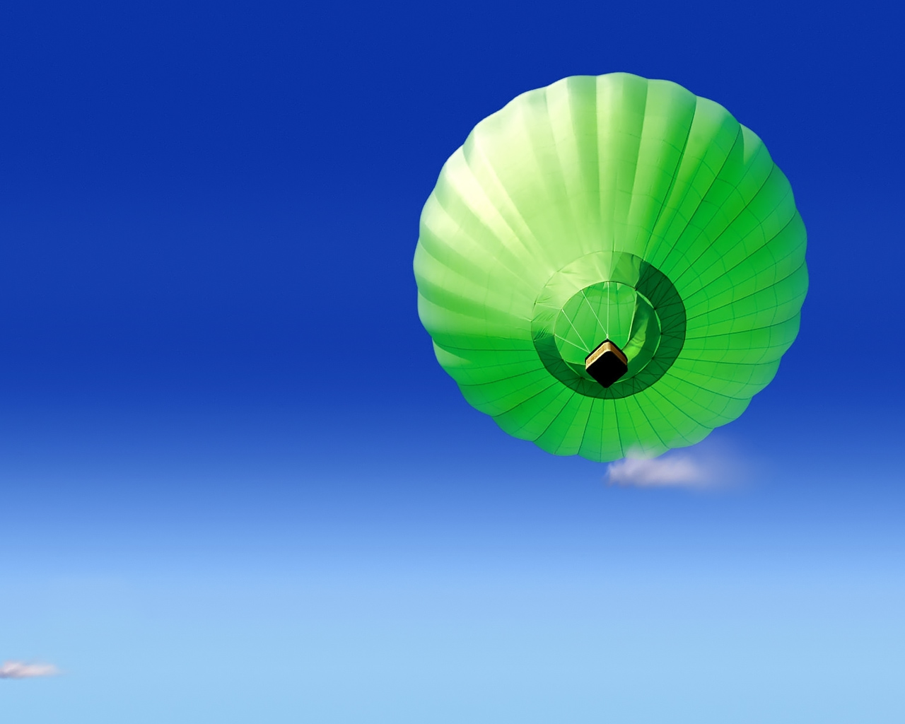Green balloon on the sky